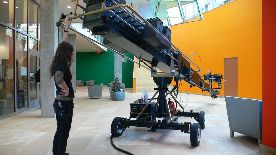 Vanessa the Dolly Grip with the 25 foot telescopic crane in the Frank Gehry designed lower lobby of the new Lewis Science Library at Princeton.